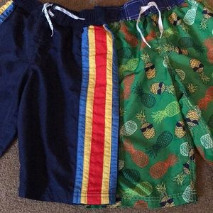 Two boys bathing suits for one price.